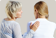 Picture of a woman rubbing another womans' back